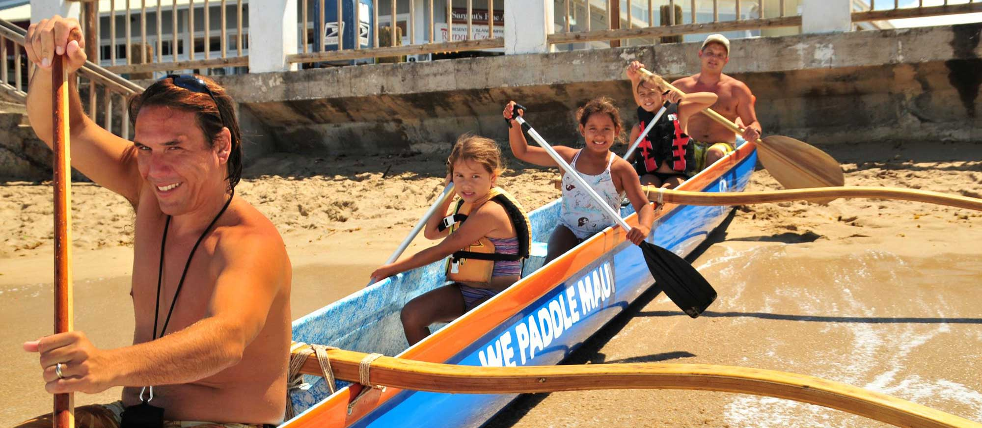 learn to paddle a Hawaiian outrigger canoe