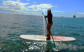 woman paddle boarding on Maui
